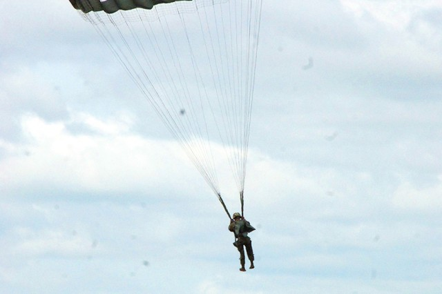 A Pathfinder student prepares to execute a parachute landing fall during the course.
