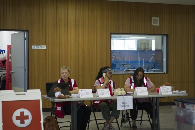 American Red Cross representatives show their preparedness at their station during the EEC setup exercise conducted by USAG Japan DPTMS Aug. 31 at Yano Fitness Center. (U.S. Army photo by Alia Naffouj)