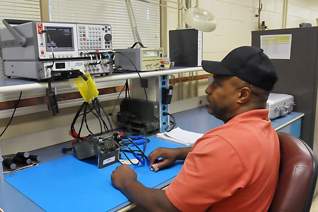 An LRC-Bragg technician performs a series of diagnostic tests to determine any problems with this SINCGARS radio in the Communications and Electronics Shop. (Photo by Jon Micheal Connor, ASC Public Affairs)
