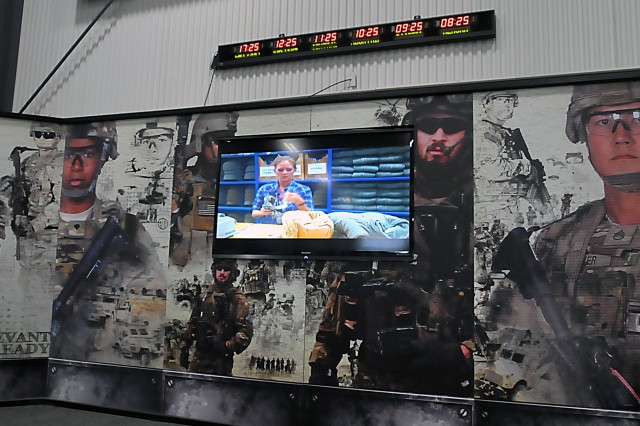 Shown is a video screen encased in a display that greets customers at LRC-Bragg's Clothing Issue Facility showing them what they will be issued at Fort Bragg, North Carolina. (Photo by Jon Micheal Connor, ASC Public Affairs)