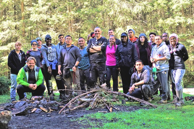 Wiesbaden Better Opportunities for Single Soldiers members pose for a group photo with survival life skills trainers.