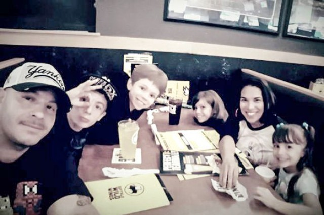 Chief Warrant Officer 3 Manuel Marrero, his wife Mayda, and their four children, at their weekly Buffalo Wild Wings dinner.
