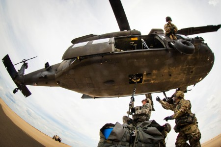 Soldiers with the 407th Brigade Support Battalion, 2nd Brigade Combat Team, attach a sling-load to the belly of a UH-60 Black Hawk assigned to the 82nd Combat Aviation Brigade, during a sling load training event at Holland Drop Zone on Fort Bragg, N.C., Aug. 24, 2016.