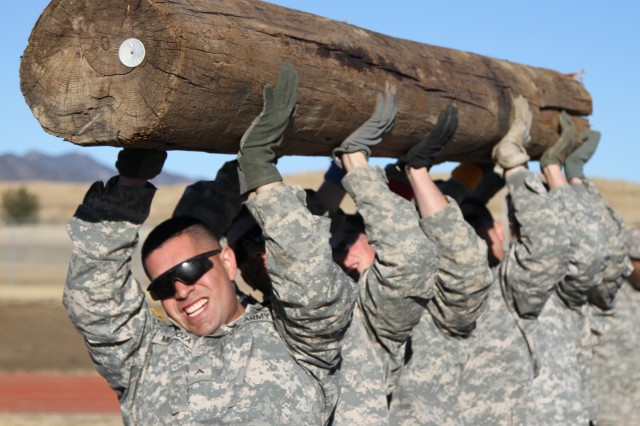 Teamwork -- Soldiers monitoring for signs of distress in fellow Soldiers -- can help lower suicide rates, experts say. Shown here to depict teamwork, Soldiers of Company C, 2nd Battalion, 23rd Infantry Regiment, 1st Stryker Brigade Combat Team, 4th Infantry Division, work as a six member team to lift a heavy log over their heads 20 times while competing in the Ivy Heptathlon during Iron Horse Week in 2015.
