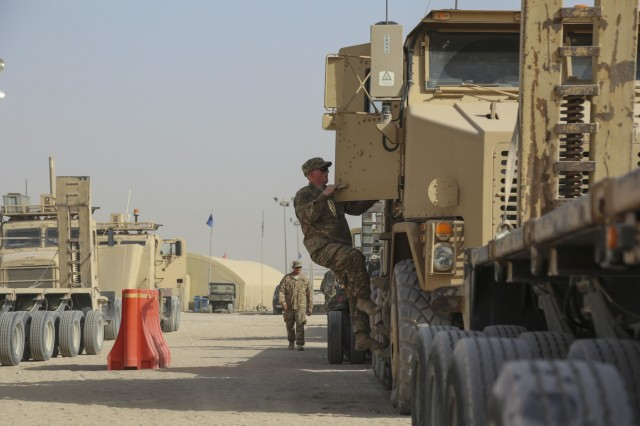 A Soldier with the 109th Transportation Company, 553rd Combat Sustainment Support Battalion, 17th Sustainment Brigade, 1st Sustainment Command (Theater), climbs into a heavy equipment transport at Camp Arifjan, Kuwait, June 9, 2016. The 109th TC is out of Joint Base Elmendorf-Richardson, Alaska, and left temperatures in the 30s to drive in temperatures regularly topping 120 degrees.