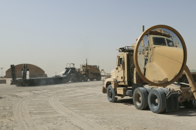 A heavy equipment transport with the 109th Transportation Company, 553rd Combat Sustainment Support Battalion, 17th Sustainment Brigade, 1st Sustainment Command (Theater), pulls out to take its place in a convoy leaving from Camp Arifjan, Kuwait, June 9, 2016. Since it deployed in March, convoys with the 109th TC have traveled over 200,000 miles.
