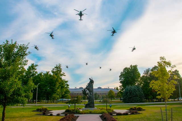 Pilots from both 10th Combat Aviation Brigade and Utah National Guard fly 6th Squadron, 6th Cavalry Regiment's Apaches inbound for the first time in a low formation over Hays Hall and Memorial Park at Fort Drum on Aug. 17. The flight completes one part of the Aviation Restructure Initiative in equipping 10th Mountain Division (LI) with a capable aviation force ready for future missions.