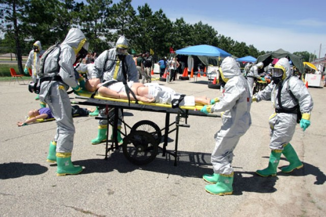 Soldiers work to decontaminate an area during Vibrant Response, an exercise that simulates the detonation of a nuclear device at Camp Atterbury, Ind. First Army Soldiers provided the exercise's observer coach/trainer support.