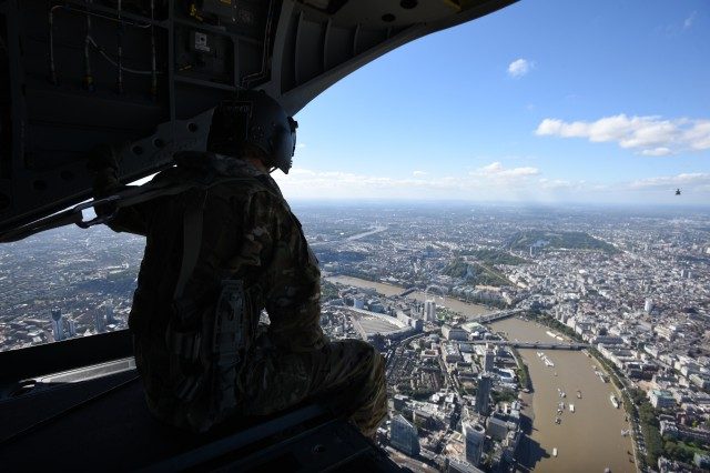 Sgt. Randall Roberge, a 15U Chinook Helicopter Mechanic, 12th Combat Aviation Brigade, observes the view of downtown London during a flight with Secretary of Defense Ash Carter, Sept. 7, 2016.  Carter traveled to the UK and Norway to meet with allies and discuss UN peacekeeping operations.