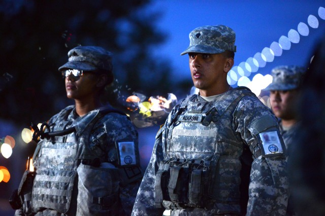Sgt. Tiffany Roman, and Spc. Omar M. Alkasimi, both part of Joint Task Force Empire Shield, stand in formation, Aug. 17, 2016, at Fort Hamilton, New York.  Afterward, they will spend the day standing guard in one of several transit hubs around New York City, with the goal of detecting and deterring terrorism.
