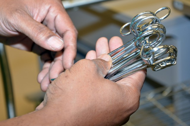 Surgeons require numerous pairs of scissors during a surgical procedure. To eliminate unnecessary touching and to preserve sterility, surgical instruments are arranged in order of use. Throughout the disinfection and sterilization process, Carl R. Darnall Army Medical Center's medical technicians incorporate multiple quality-control steps to ensure instrument integrity.