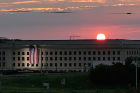 Sunrise at the Pentagon prior to a ceremony to commemorate the 15th anniversary of the Sept. 11, 2001 terror attacks. The American flag is draped over the site of impact at the Pentagon. In 2008, the National 9/11 Pentagon Memorial opened adjacent to the site, located on Boundary Channel Drive in Arlington, Va., and commemorates the 184 lives lost at the Pentagon and onboard American Airlines Flight 77 during the terrorist attacks.