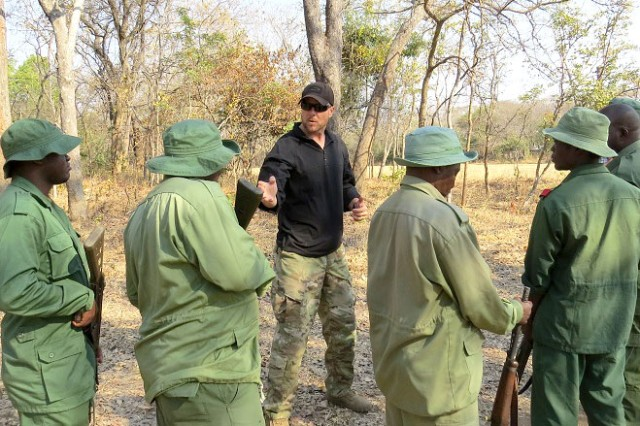 U.S. Army Staff Sgt Smith, 403rd Civil Affairs Battalion counter poaching instructor, demonstrates techniques for engaging an enemy April 3, 2016, at Rungwa Game Reserve, Tanzania. Members of the 403rd CA BN, along with North Carolina Army National Guard, have been training Tanzania Rangers in anti-poaching tactics. Poaching and trafficking in wildlife has become a source of revenue for violent extremist organizations on the continent. (Courtesy photo provided by Army Sgt. Billy Allen.)