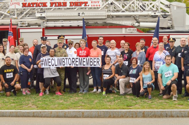 Personnel from the Natick Soldier Systems Center and the Natick Police and Fire Departments pose for a photo Sept. 9, prior to participating in the stair-climb challenge to symbolize the sacrifices our first responders make every day.