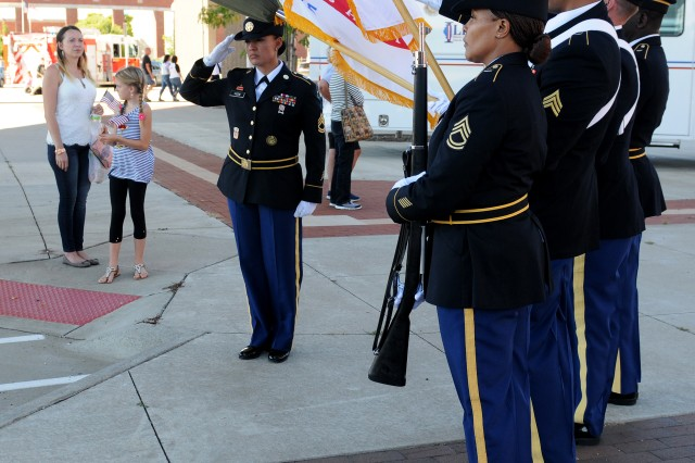 Sgt. 1st Class Chrystal Yazzie, color guard non-commissioned officer in charge, U.S. Army Sustainment Command, salutes after casing the American flag in Davenport, Iowa, Sept. 11. (Photo by Sgt. 1st Class Shannon Wright, ASC Public Affairs)