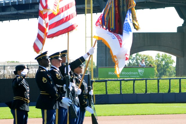 "The U.S. Army Sustainment Command color guard presents the American flag during the national anthem at the Modern Woodmen of America ""Salute to Heroes"" community event in Davenport, Iowa, Sept. 11. (Photo by Sgt. 1st Class Shannon Wright, ASC Public Affairs)"