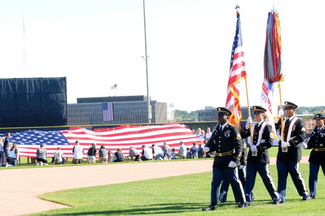 "The U.S. Army Sustainment Command color guard team exits the stadium after presenting the colors prior to the Modern Woodmen of America ""Salute to Heroes"" community event in Davenport, Iowa, Sept. 11. (Photo by Sgt. 1st Class Shannon Wright, ASC Public Affairs)"