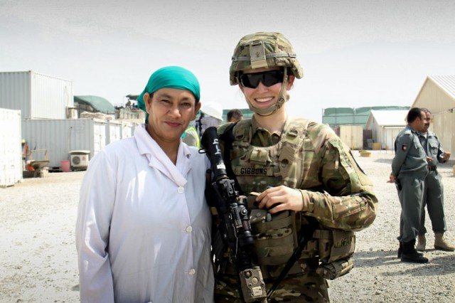Army 2nd Lt. Eva Gibbons, assigned to the 3rd Cavalry Regiment, stands with Yassmin, her Afghan counterpart, during an advising engagement at the 202nd Police Zone Regional Training Center in Nangarhar province, Afghanistan, July 14, 2016. Yassmin is a doctor and is currently the only female working at the RTC.