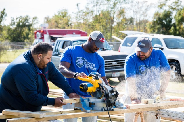 The Mission Continues volunteer veterans in Houston build outdoor benches at a local elementary school, January 2015.