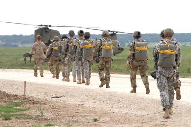 Paratroopers with Delta Company, 52nd Infantry Regiment (Long Range Surveillance), walk toward a CH-47 Chinook on Rapido Drop Zone Sept. 1, 2016, at Fort Hood to conduct their final jump.