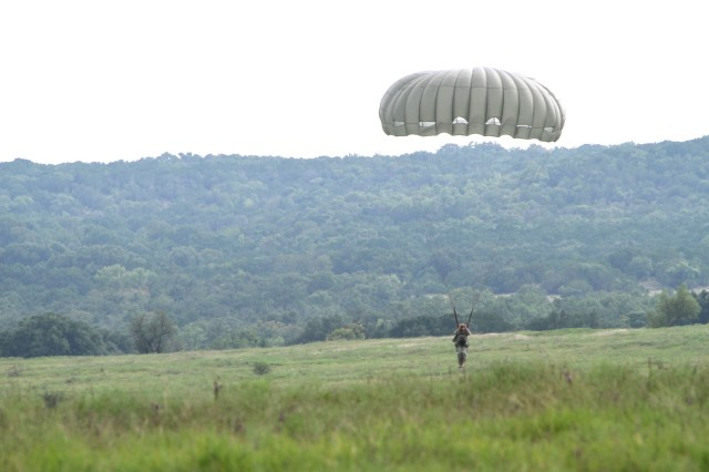 A paratrooper with Delta Company, 52nd Infantry Regiment (Long Range Surveillance) prepares to conduct a proper Parachute Landing Fall at Rapido Drop Zone Sept. 1, 2016, at Fort Hood.