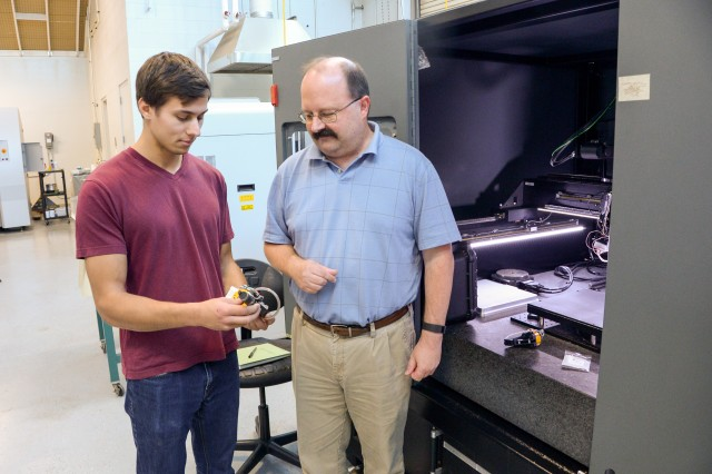 Dr. Vince Hammond (right), a materials engineer with the U.S. Army Research Laboratory, and Ryan Oshinsky, an intern who is majoring in computer engineering at Case Western University, examine a part produced by additive manufacturing at ARL's Micro Compositronics and Rapid Operations Lab at Aberdeen Proving Ground, Maryland.