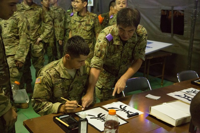 During Orient Shield, Soldiers get a chance to interact with their Japanese counterparts in cultural activities, such as calligraphy, Sept. 8, 2016.