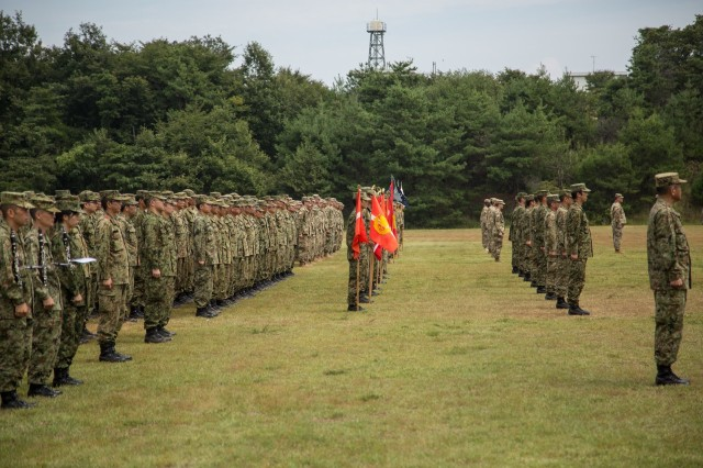 Soldiers with 25th Infantry Division, 2nd Infantry Division, and members of the Japan Ground Self Defense Force (JGSDF) in formation for the opening ceremony for Orient Shield 2016, Sept. 11, 2016.