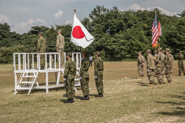 Exercise directors from JGSDF and US Army Japan conduct the opening ceremony to officially begin Orient Shield 2016, Sept. 11, 2016.