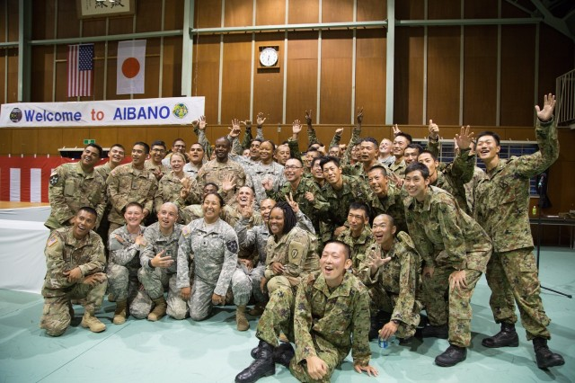 Soldiers with 25th Infantry Division, 2nd Infantry Division, and members of the Japan Ground Self Defense Force (JGSDF) join together to take a group photo at the welcoming party, Sept. 9, 2016.