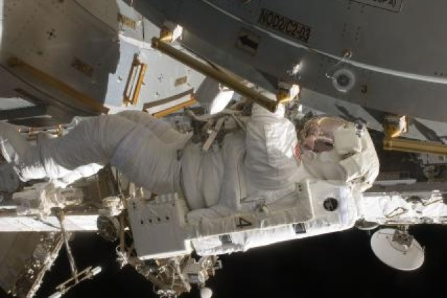 Astronaut Col.Tim Kopra works to prepare the berthing mechanisms on the Kibo laboratory and the Japanese Exposed Facility for installation onto the International Space Station in July 2009, during his first of two space flights.