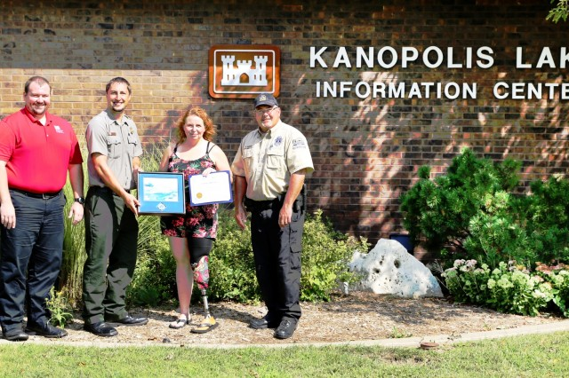 Amy Bruecks receives the U.S. Army Corps of Engineers Certificate of Appreciation and Kansas Department of Wildlife, Parks, and Tourism lifesaving award.   Pictured from left to right, Heath Kruger, natural resource management specialist, USACE Kansas City District, Ryan Williams, USACE Kanopolis Lake manager; Amy Bruecks; Greg Salisbury, Kansas Department of Wildlife, Parks, and Tourism game warden.  Photo by Kyle Burgoon.