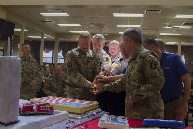Col. Stanley Sliwinski, commander of the 101st Airborne Division Sustainment Brigade, 101st Abn. Div. (Air Assault), Brig. Gen. Scott Brower, acting senior commander for the 101st Abn. Div. (Air Assault), and representatives from the police and fire departments from Oak Grove, Ky., and Hopkinsville, Ky., cut a memorial cake at the 101st Abn. Div. Sust. Bde. dining facility on Fort Campbell, Ky., Sept. 9, 2016, during the Sept. 11, 2001 memorial luncheon. (U.S. Army photo by Sgt. Neysa Canfield/101st Airborne Division Sustainment Brigade Public Affairs)