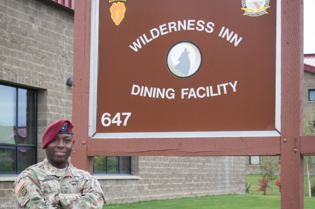 Chief Warrant Officer 2 Elbert Scott poses outside the Wilderness Inn on Joint Base Elmendorf-Richardson September 14, 2016. With 23 years of service under his belt, the chief warrant officer 2 has spent his time in Alaska continuing to advance the USARAK culinary arts program and starting an apprentice program with the Glacier Brewhouse here in Anchorage. (U.S. Army photo/Sachel Harris)