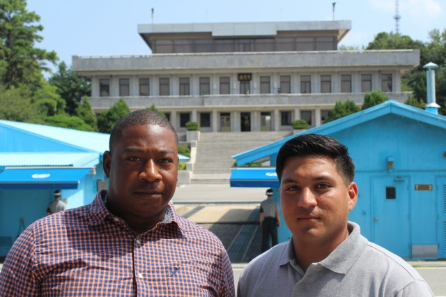 """Sgt. Byron Nunn and Spc. Salomn Garcia-Padilla, Forward Support Company J, 2nd Battalion, 8th Cavalry Regiment """"Stallions,"""" 1st Armored Brigade Combat Team, 1st Cavalry Division, visit the Joint Security Area in the Demilitarized Zone separating North and South Korea, as part of a tour Aug. 16. Soldiers visited the JSA, Camp Bonifas, the """"Bridge of No Return"""" and several other points of interest, during the tour. (U.S. Army photo by Spc. Jeremy Reuse, 2nd Battalion, 8th Cavalry Regiment, 1st Armored Brigade Combat Team, 1st Cav. Div.)"""