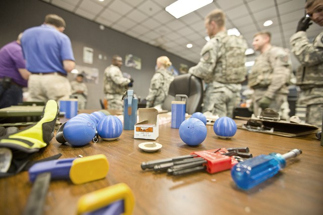Soldiers, Marines and engineers gather to evaluate and down-select various grenade body and arming designs.