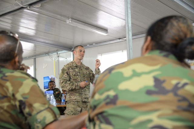 U.S. Army Maj. Andrew Mosier 403rd Civil Affairs Battalion physician, shares effective medical practices with African Union Mission in Somalia and Somali combat medics about methods of providing casualty care under hostile fire during the AMISOM Sector Medical Conference in Mogadishu, Somalia, Sept. 6, 2016. During the conference, medics practiced triage, a method of prioritizing care among multiple casualties to save the most lives, applying multiple tourniquets in a mass casualty exercise and maintaining effective communication in a crisis. (U.S. Air Force photo by Staff Sgt. Benjamin Raughton)