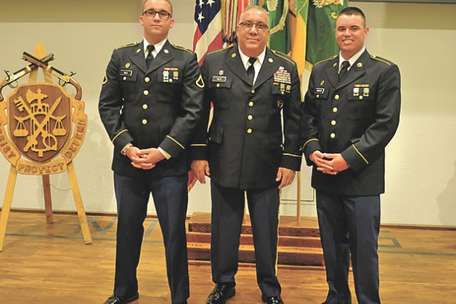 From left, Pfc. Tyler Vila, retired Command Sgt. Maj. Luis Vila and Pvt. Justin Robles pose for a three-generation Fort Leonard Wood BCT graduation photo.