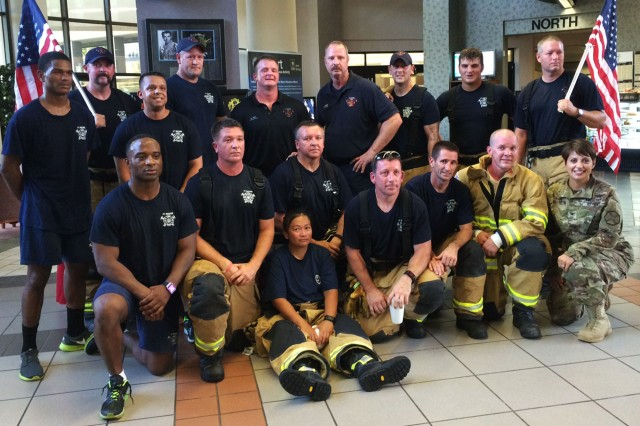 Col. Shannon T. Miller, Fort Rucker garrison commander, poses with Fort Rucker firefighters following their climb.