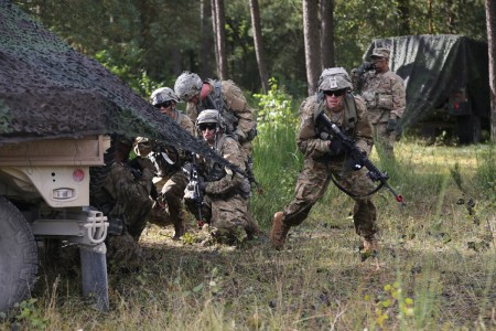 A U.S. Soldier of 1st Battalion, 4th Infantry Regiment, assaults an objective while conducting a raid during exercise Combined Resolve VII at the U.S. Army's Joint Multinational Readiness Center in Hohenfels Germany, Sept. 6, 2016. Combined Resolve VII is designed to train the Army's regionally allocated forces to the U.S. European Command, and includes more than 3,500 participants from 16 NATO and European partner nations.