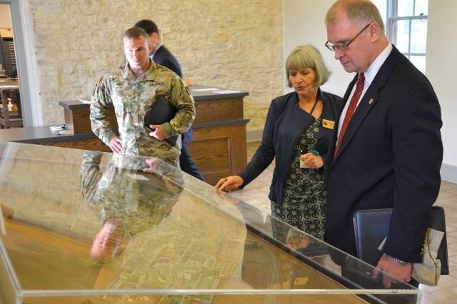Jacqueline Davis shares the history of the Fort Sam Houston infantry post with John Lyle during a visit to the Army North Quadrangle Sept. 14 to Joint Base San Antonio-Fort Sam Houston, Texas. Davis is the director of the Fort Sam Houston Museum and Lyle is the Army Contracting Command deputy to the commanding general.