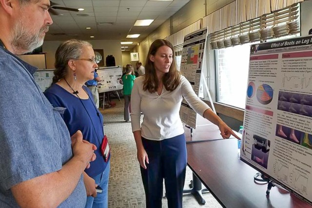 Postdoctoral fellow Dr. Carolyn Hampton (right) from the U.S. Army Research Laboratory's Soldier Protection Sciences Branch presents her research to Drs. Rose Pesce-Rodriguez and Jeffrey Morris Sept. 13, 2016 at the lab's inaugural Postdoc Research Day event at Aberdeen Proving Ground, Maryland.