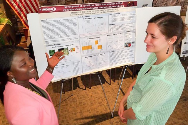 Postdoctoral fellow Dr. Theresah Zu (left), explains her research to Dr. Sarah Stellwagen during Sept. 13 research day event. Zu is co-chair of the U.S. Army Research Laboratory Postdoctoral Association.