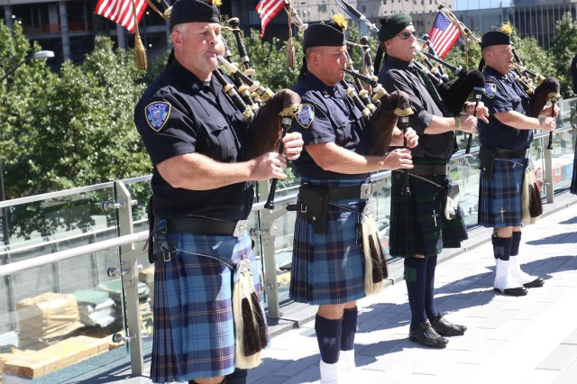 The Pipes & Drums Of The Emerald Society of the New York City Police Department plays during the America's Response Ceremony. The America's Response Monument, aka Horse Soldier statue, sits in its final resting place at Liberty Park, adjacent to the 9/11 Memorial in New York City. The statue serves as a reminder of the bond formed between U.S. Special Operations Forces and the New York City first responders. (U.S. Army photo by Capt. Eric Hudson, 160th SOAR Public Affairs.)