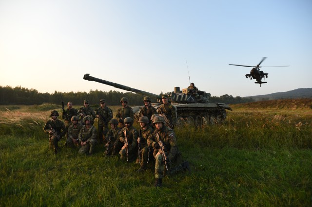 Czech and British Soldiers pose in front of a T-72 and AH-64 Apache after a graded JTAC iteration at Ample Strike 16, Sept. 5-16, near Libava, Czech Republic.  Ample Strike 16 is the third iteration of a Czech Republic-led Joint Terminal Attack Controller (JTAC) air-to-ground live fire exercise with over 1,500 participants from 18 countries.