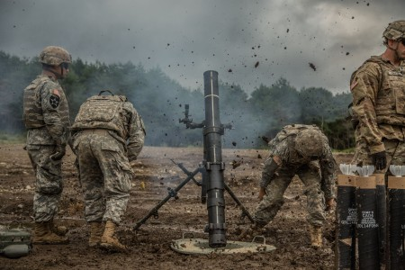 Mortar-men with Headquarters Company, 2nd Battalion, 27th Infantry Regiment, fire the M120 Battalion Mortar System at Albano Training Area, Japan, Sept. 13, 2016, as part of Orient Shield 2016. Orient Shield is an annual bi-lateral training exercise held in Japan.