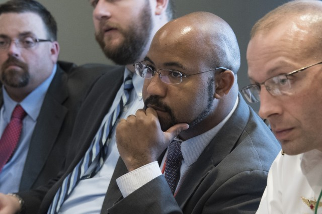 U.S. Army Security Assistance Command's Curtis Thomas, center, listens to a briefing during the Saudi Grand Security Assistance Review held in Washington, D.C., Oct. 18-23.