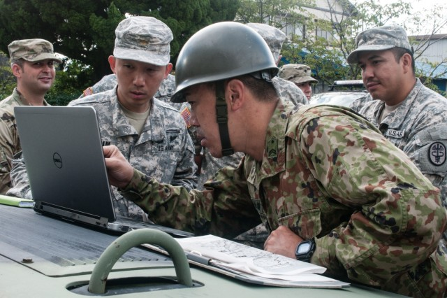 Army Maj. Donald Kim (left), U.S. Army liaison officer for the Japan Ground Self-Defense Force Eastern Army and Central Readiness Force, and JGSDF Sgt. 1st Class Yamanashi Yoshihiro (right), escort noncommissioned officer-in-charge, 2nd Company, 34th Infantry Regiment, JGSDF Eastern Army, finalize the route for a vehicle convoy Sep. 4, 2016, in Kakegawa, Japan. The U.S. Army and JGSDF bilateral convoy simulated a humanitarian relief mission as part of the Shizuoka Prefecture Comprehensive Disaster Drill. The drill demonstrated how a diverse collection of local, regional, national and international organizations can pool their respective resources to effectively respond to a major disaster. In addition to coordinating convoy routes, the contingent of U.S. Army troops collaborated with their JGSDF counterparts to provide casualty care, establish mobile communication site and set up supply distribution points. (Photo by Sgt. John L. Carkeet IV, U.S. Army Japan)