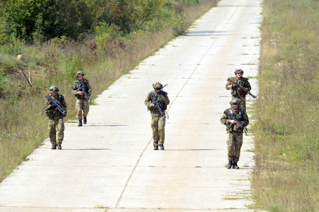 Soldiers from the Croatian Armed Forces mobile infantry, return from route reconnaissance while at the Eugen Kvaternik training range in Slunj, Croatia, in preparation to occupy an assembly area as part of exercise Immediate Response 16, Sept. 13, 2016. Immediate Response 16 utilizes computer-assisted simulations and field training exercises spanning two countries, Croatia and Slovenia. It is designed to enhance regional stability, strengthen allied and partner nation capacity, and improve interoperability among partner nations. (U.S. Army photo by Staff Sgt. Opal Vaughn)