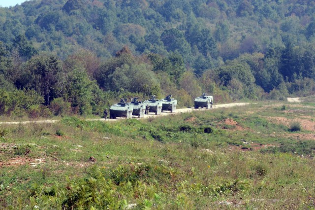 Croatian Patria Armored Modular Vehicles in a convoy, move to occupy an assembly area, Sept. 13, 2016, at the Eugen Kvaternik training range Slunj, Croatia, as part of exercise Immediate Response 16. Immediate Response 16 utilizes computer-assisted simulations and field training exercises spanning two countries, Croatia and Slovenia. It is designed to enhance regional stability, strengthen allied and partner nation capacity, and improve interoperability among partner nations. (U.S. Army photo by Staff Sgt. Opal Vaughn)
